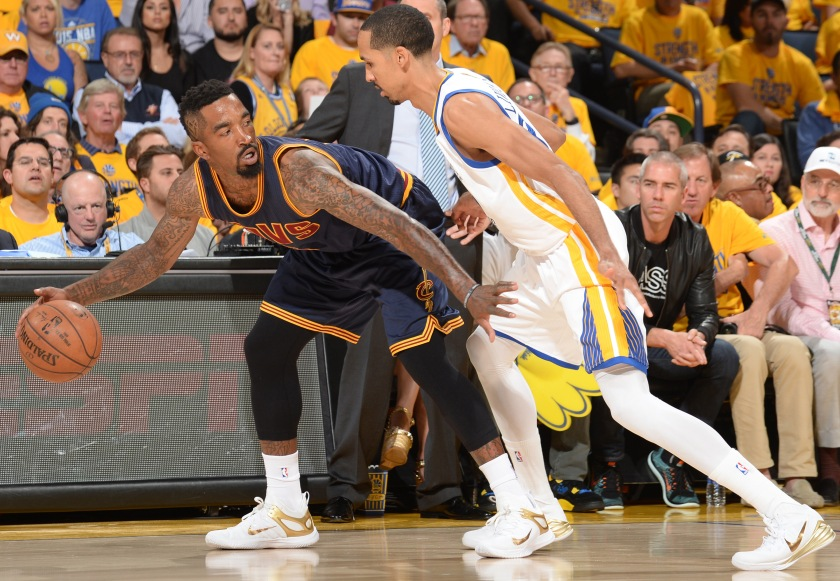 OAKLAND, CA - JUNE 4: J.R. Smith #5 of the Cleveland Cavaliers handles the ball against the Golden State Warriors in Game One of the 2015 NBA Finals on June 4, 2015 at Oracle Arena in Oakland, California. NOTE TO USER: User expressly acknowledges and agrees that, by downloading and or using this photograph, user is consenting to the terms and conditions of Getty Images License Agreement. Mandatory Copyright Notice: Copyright 2015 NBAE (Photo by Noah Graham/NBAE via Getty Images)