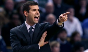 Boston Celtics head coach Brad Stevens calls to his players during the first quarter of an NBA basketball game against the Minnesota Timberwolves in Boston, Friday, Dec. 19, 2014. (AP Photo/Charles Krupa)