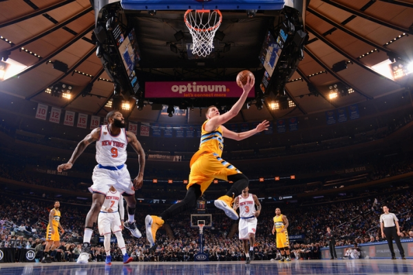 NEW YORK, NY - FEBRUARY 10:  Nikola Jokic #15 of the Denver Nuggets goes to the basket against the New York Knicks on February 10, 2017 at Madison Square Garden in New York City, New York.  NOTE TO USER: User expressly acknowledges and agrees that, by downloading and or using this photograph, User is consenting to the terms and conditions of the Getty Images License Agreement. Mandatory Copyright Notice: Copyright 2017 NBAE  (Photo by Jesse D. Garrabrant/NBAE via Getty Images)